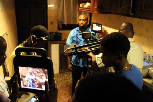 Actor Seun Akindele in the kitchen, the weight of the world on his character's shoulders.